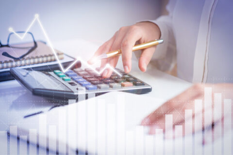 accountant-calculating-profit-with-financial-analysis-graphs_74855-4937