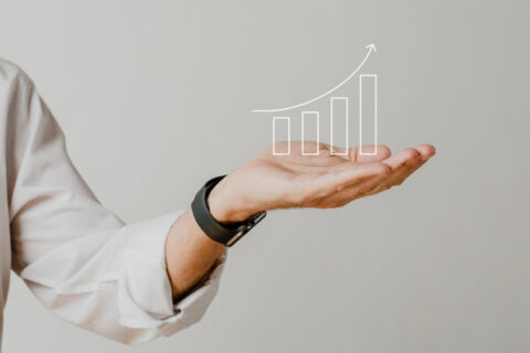 digital-increasing-bar-graph-with-businessman-hand-overlay (1)
