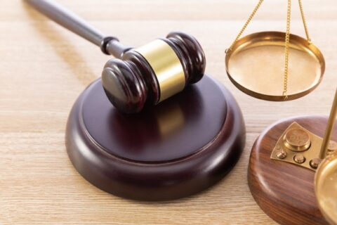 high-angle-shot-gavel-scale-wooden-surface_181624-33848